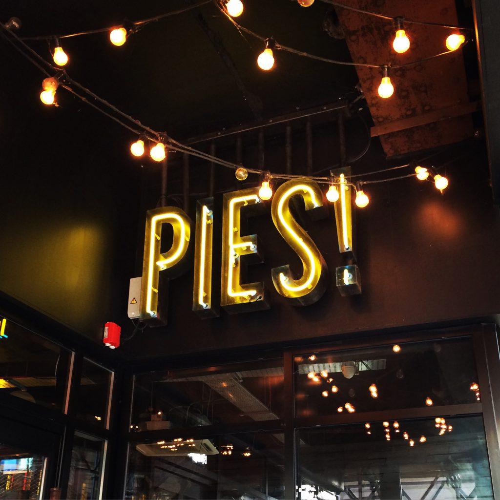 Sign inside restaurant: Pies!